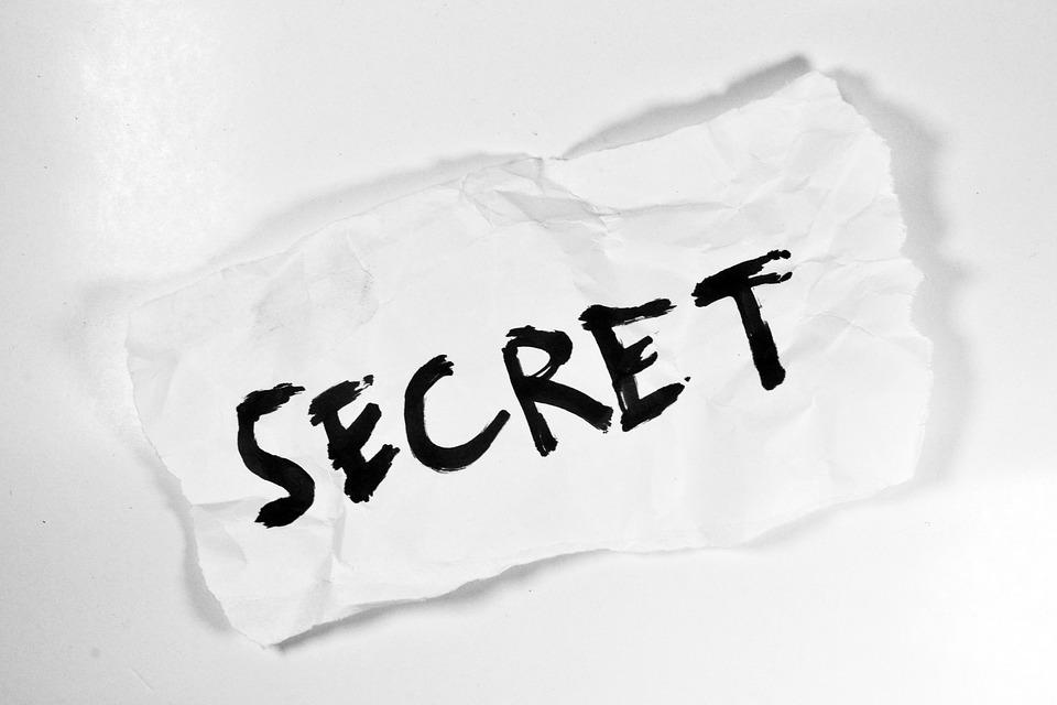 secret written on a piece of paper